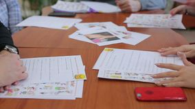 Students in English lessons. A group of students in English lessons in the classroom teaches to talk and write homework stock footage