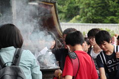 Students enjoy to be becky incense smoke toward themselves,lucky Royalty Free Stock Images