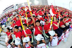 Students enjoying themselves as spectators during National Day Parade (NDP) Rehearsal 2013 Stock Photography