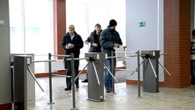 Students entering the university. Novosibirsk, Russia - January 15, 2015: Students passing through the turnstile into the Novosibirsk State University of stock footage