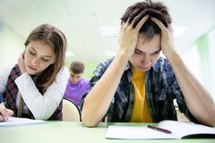Students on exam  in class. Group of students takes the test in class Royalty Free Stock Image