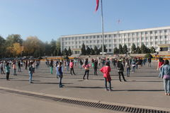 Students exercising in front of Osh town hall, kyrgyzstan Stock Images