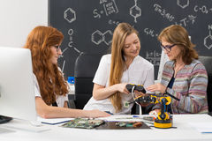 Students explaining their new project to a teacher Stock Image