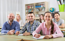 Students at extension courses. Smiling adult students of different age at extension courses in classroom Royalty Free Stock Photography