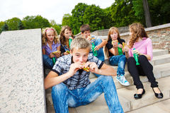 Students with fast food Royalty Free Stock Photography