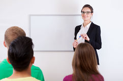 Students and female teacher in classroom Stock Photography