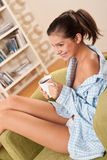 Students - Female teenager having cup of coffee Royalty Free Stock Image