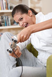 Students - Female teenager playing video game Royalty Free Stock Photo