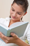 Students - Female teenager reading book Royalty Free Stock Photo