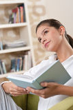 Students - Female teenager reading book Royalty Free Stock Images