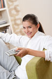 Students - Female teenager with remote control Stock Photography