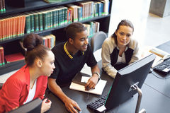 Students finding information on computer for school project Royalty Free Stock Image