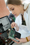 Students fixing hard drive during technology class Royalty Free Stock Photos