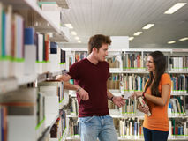 Free Students Flirting In Library Royalty Free Stock Images - 16701639