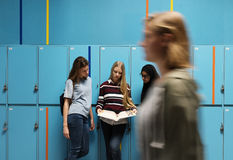 Students friends at lockers room Royalty Free Stock Images