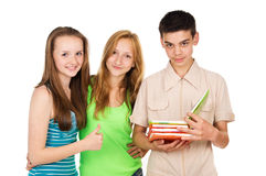 Students, friends, read a book Royalty Free Stock Photo
