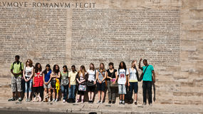 Students in front Roman inscription, Rome Royalty Free Stock Photo