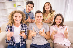 Students with gadgets stock image