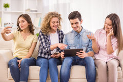 Students with gadgets Royalty Free Stock Image