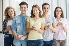Students with gadgets Stock Photography