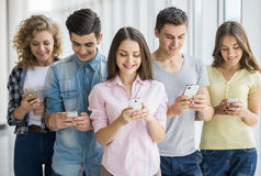 Students with gadgets Royalty Free Stock Photo