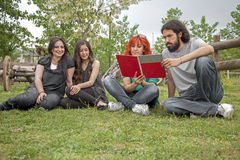 Students in garden Royalty Free Stock Image