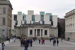 Students gathering around trinity university college in Dublin Ireland. stock photo
