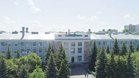 Students Get out of Petroleum Research University. KAZAN, TATARSTAN/RUSSIA - AUGUST 22 2017: Panorama students get out of petroleum research university stock video footage