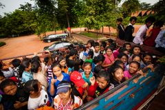 Students getting on a truck used as school bus Stock Photo