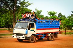 Students getting on a truck used as school bus Royalty Free Stock Images