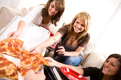 Students: Girl Happy To Grab Slice of Pizza Royalty Free Stock Photos