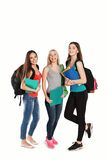 Students girl standing together on a white. Three students girl with copybooks standing together on a white background Stock Images