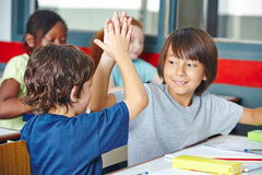 Students giving high five in class Royalty Free Stock Photography