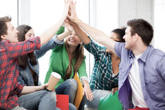 Students giving high five at school Stock Photography