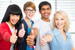 Students giving the thumbs-up sign Stock Photography
