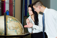 Students with globe Royalty Free Stock Images