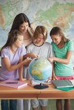 Students With a Globe Royalty Free Stock Image