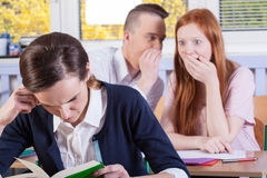 Students gossip on a lesson. Horizontal view of students gossip on a lesson Royalty Free Stock Images