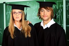 Students in gowns Royalty Free Stock Photo
