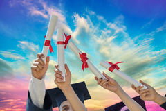 Students graduates with hats and diplomas Royalty Free Stock Photos