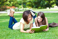Students on the grass Royalty Free Stock Photos