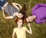 The students at green grass Stock Photography