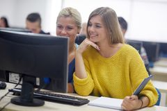 Students group in computer lab classroom Stock Photos