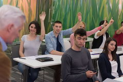 Students group raise hands up Stock Images