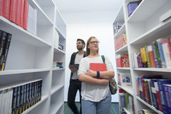 Students group  in school  library Royalty Free Stock Images