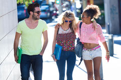 Students group talking and laughing in the street. Stock Images