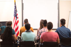 Students in hall sitting back view Royalty Free Stock Photos