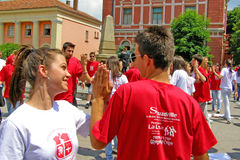 Students with hand on hand at the graduate dance parade Stock Photography