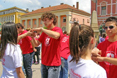 Students with hand in hand at the graduate dance parade Stock Photography