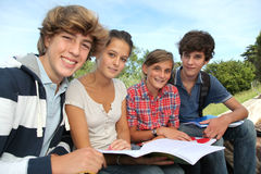 Students with handbooks in school yard stock image